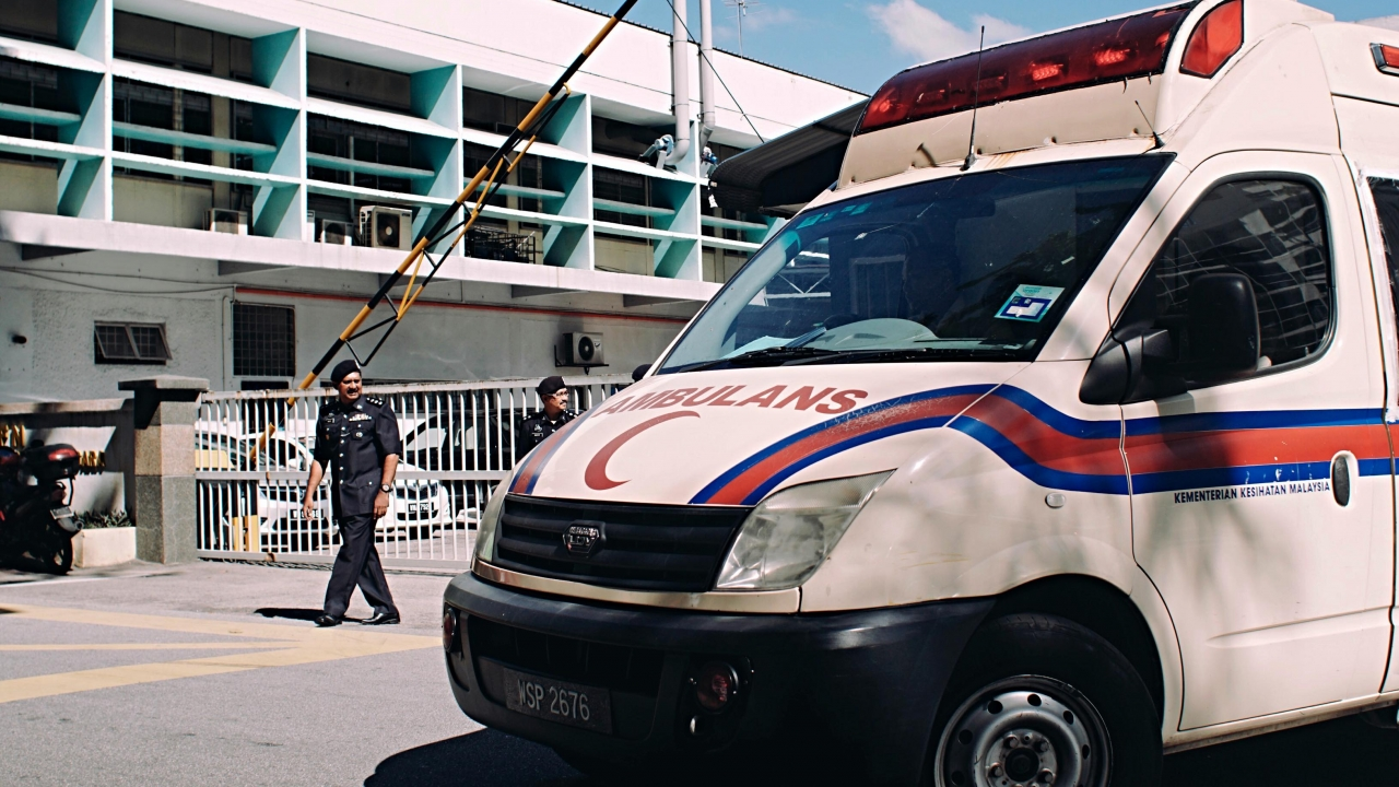 Police officers guard the entrance of the forensic department of Kuala Lumpur General Hospital.