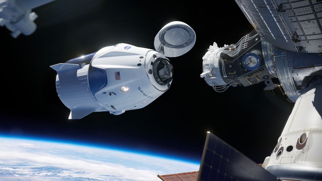 An illustration showing Crew Dragon docking with the International Space Station