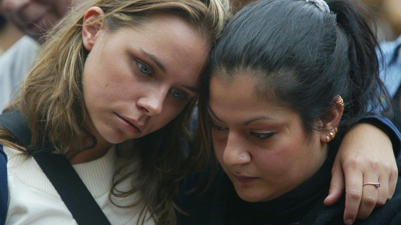 Teens saddened looking down