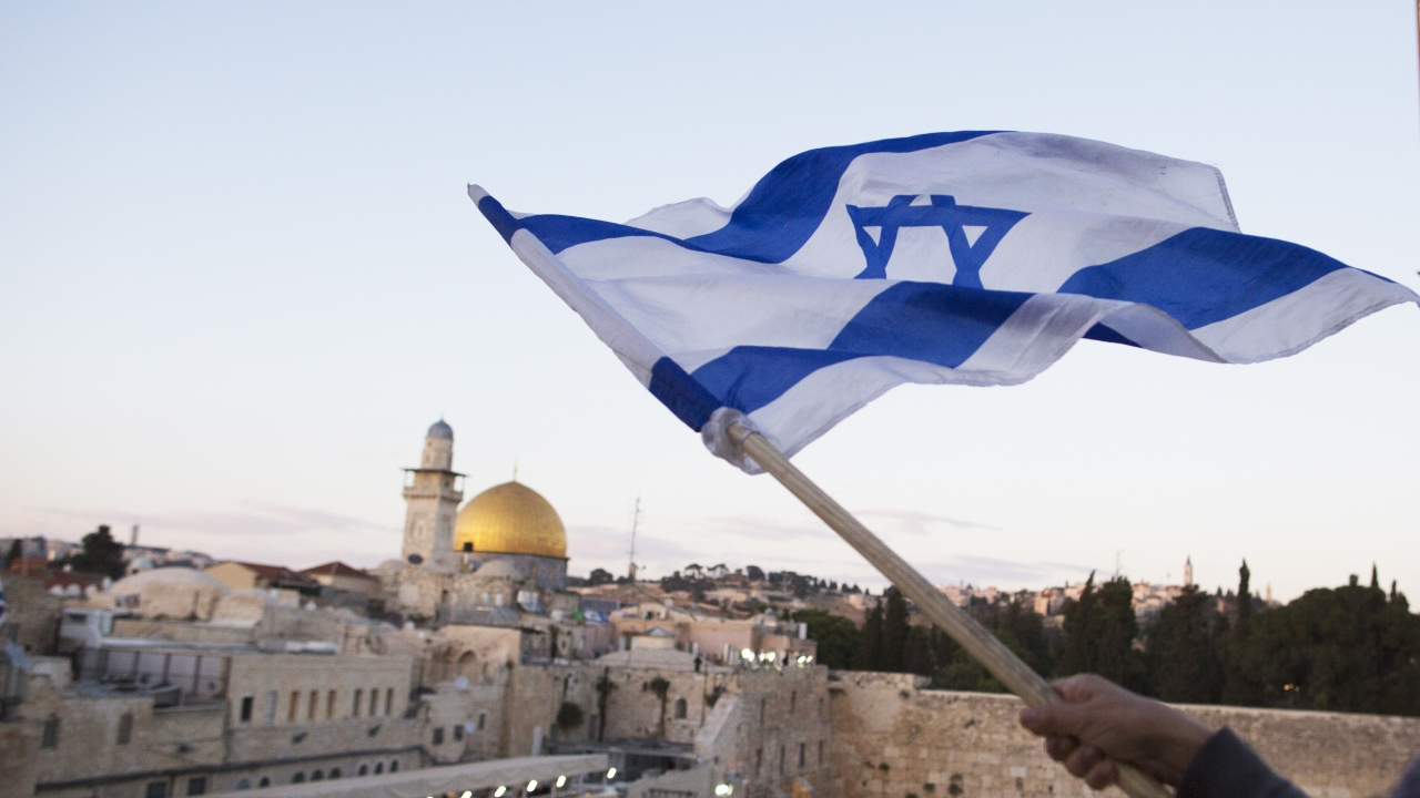 Israelis wave their national flag