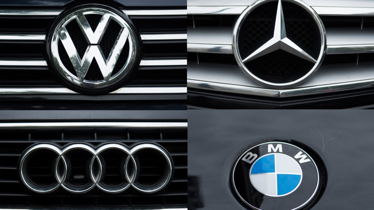 VW, Mercedes, Audi and BMW car emblems.