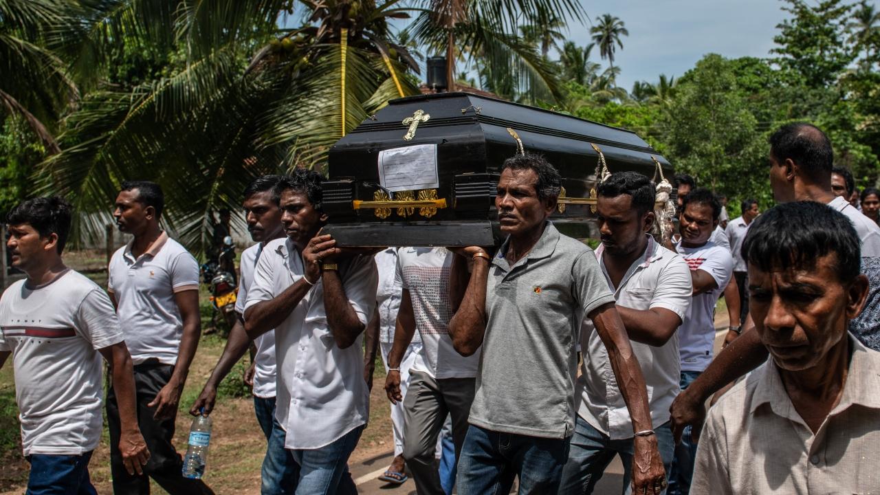 Men carrying casket