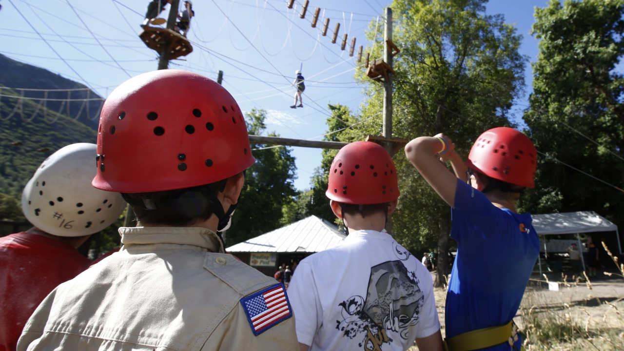Boy Scouts wait in line to climb on a ropes course