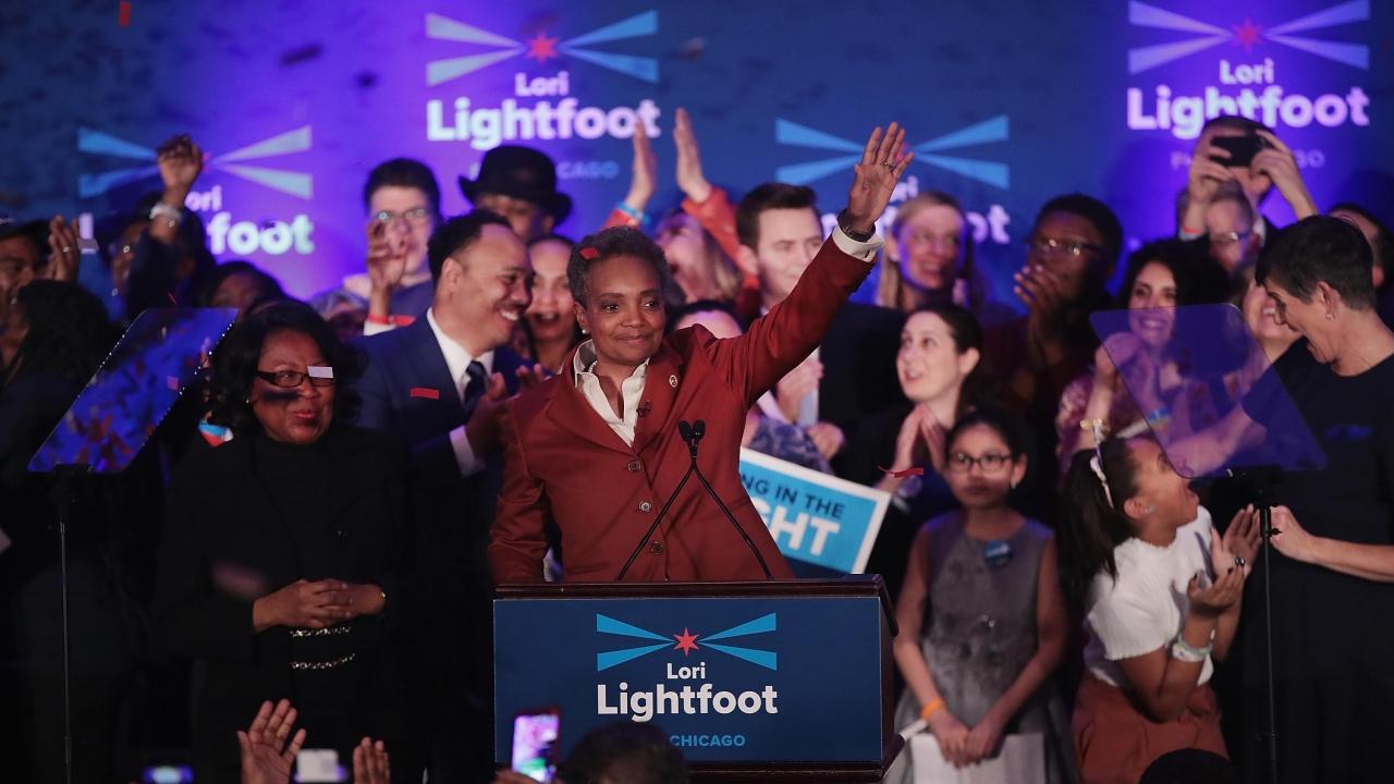 Lori Lightfoot at a podium.