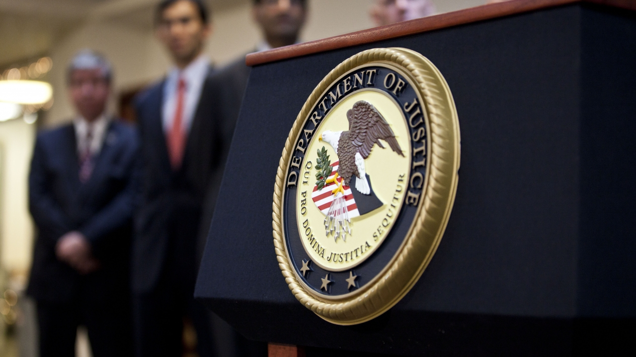 The Department of Justice seal on a podium