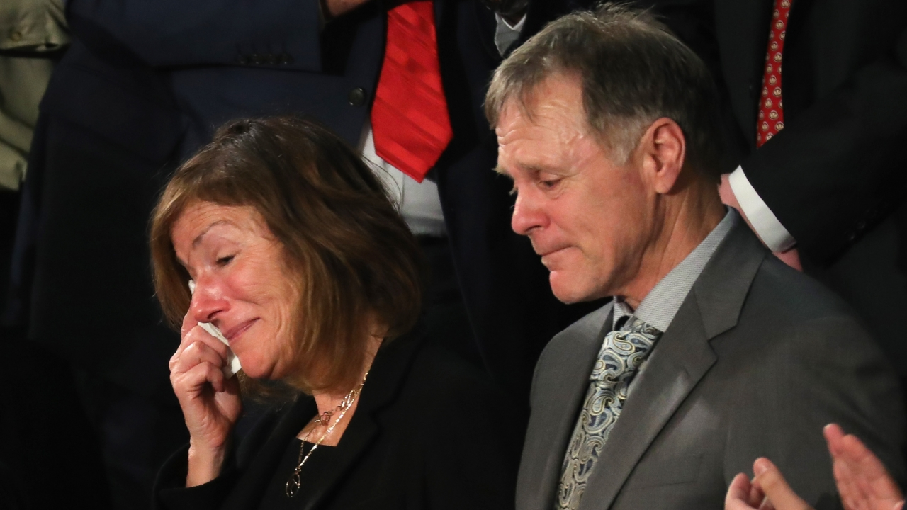 Cindy and Fred Warmbier tear up during the State of the Union address where President Trump acknowledged them in 2018.