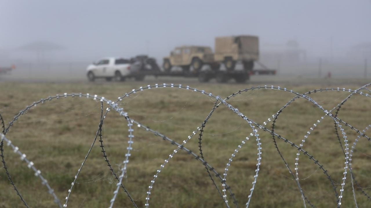 A truck moves U.S. Army vehicles near the U.S.-Mexico border