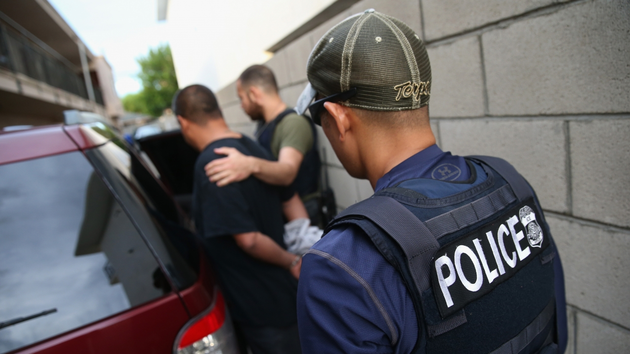 A man is detained by U.S. Immigration and Customs Enforcement