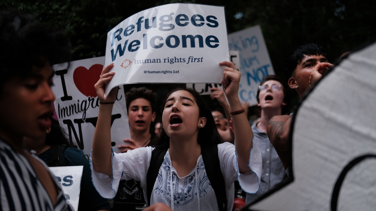 Hundreds of people gather to protest treatment of migrants and refugees in the U.S.