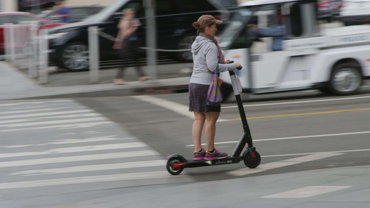 Person riding scooter in a street