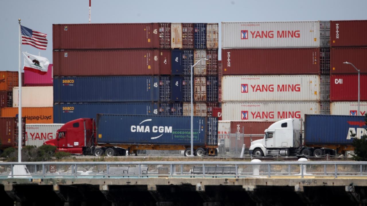 Trucks lined up at a shipping yard