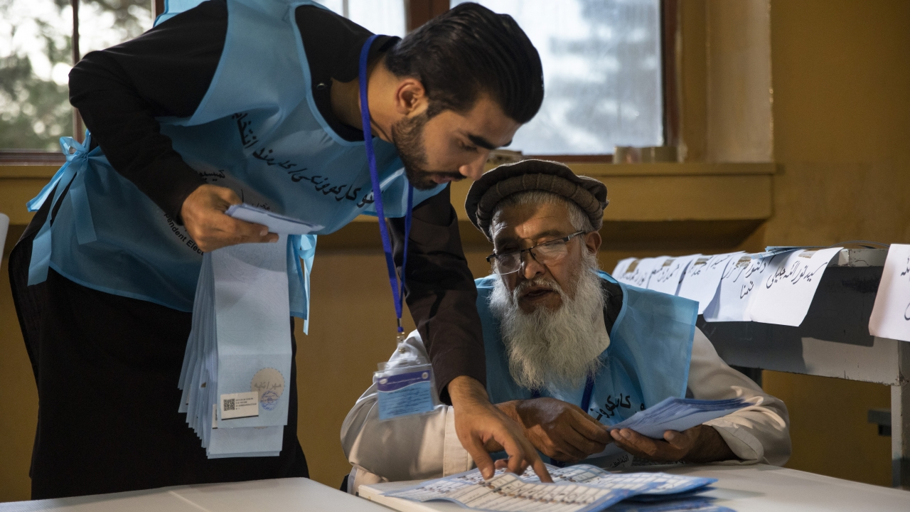 Afghan election workers start counting the ballots after light turnout and sporadic violence during the Presidential election