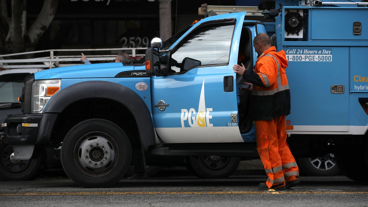 The Pacific Gas & Electric (PG&E) logo is displayed on a PG&E truck