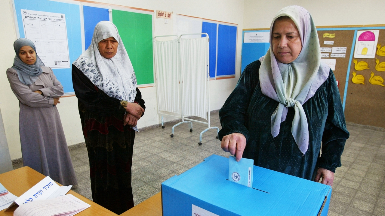 A woman turns in her ballot during an Israeli general election