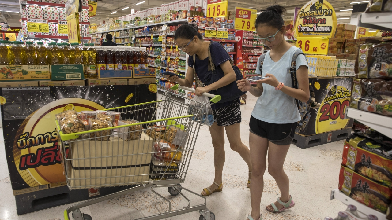 Shoppers stock up at a discount supermarket in Pattaya, Thailand