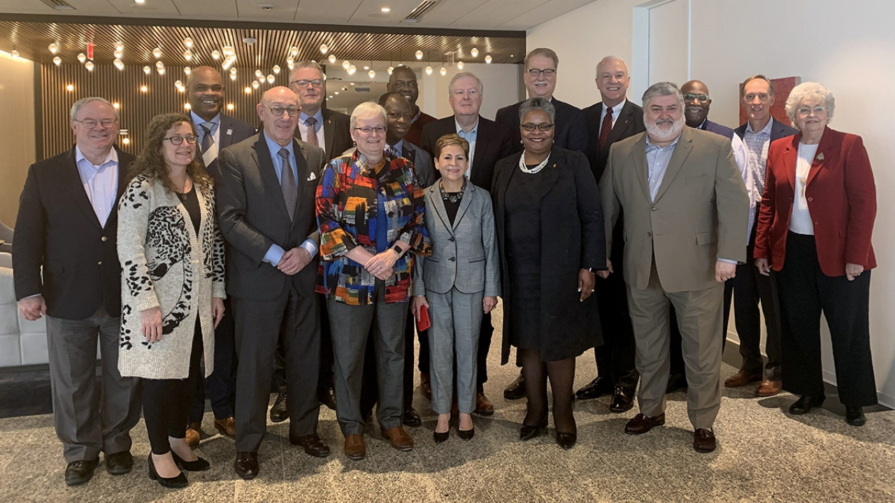 A group of bishops and other United Methodist leaders gather after reaching an agreement on a separation plan