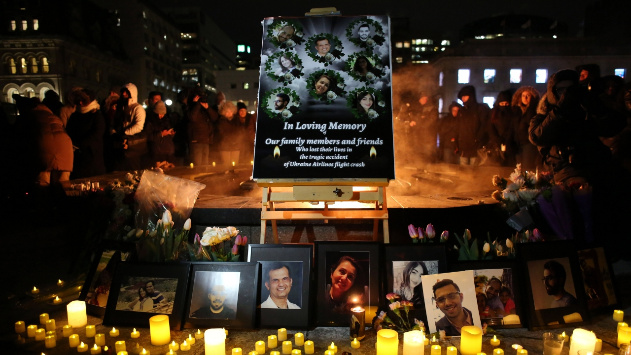 An altar with photographs of the victims who were killed in a plane crash in Iran