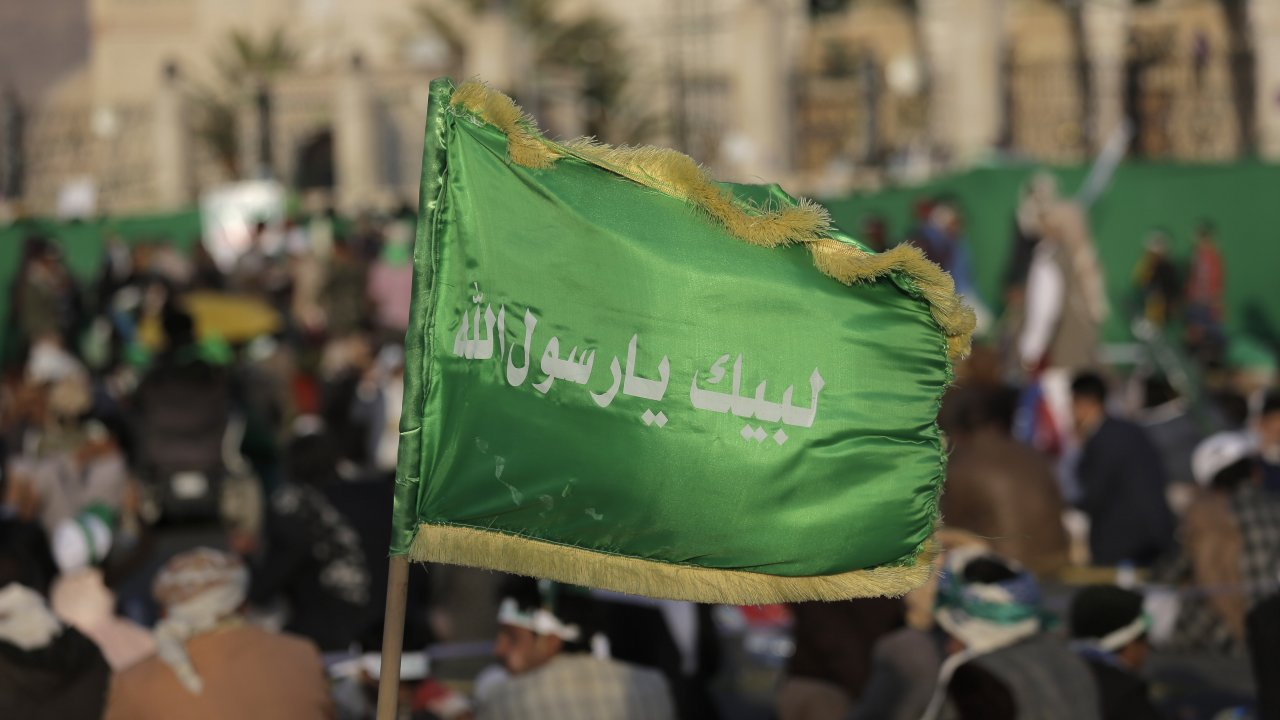 In this file photo, a supporter of Shiite rebels, known as Houthis, holds a banner.