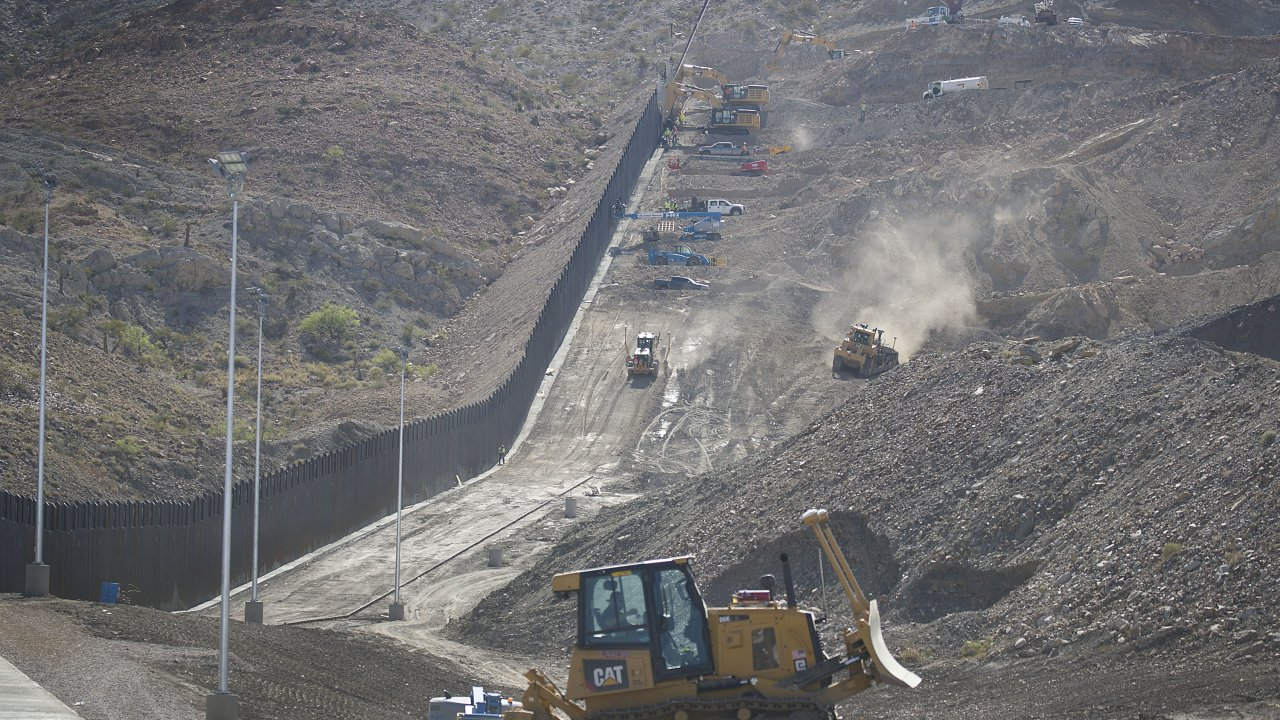 Construction crews work on a border wall in Sunland Park, New Mexico