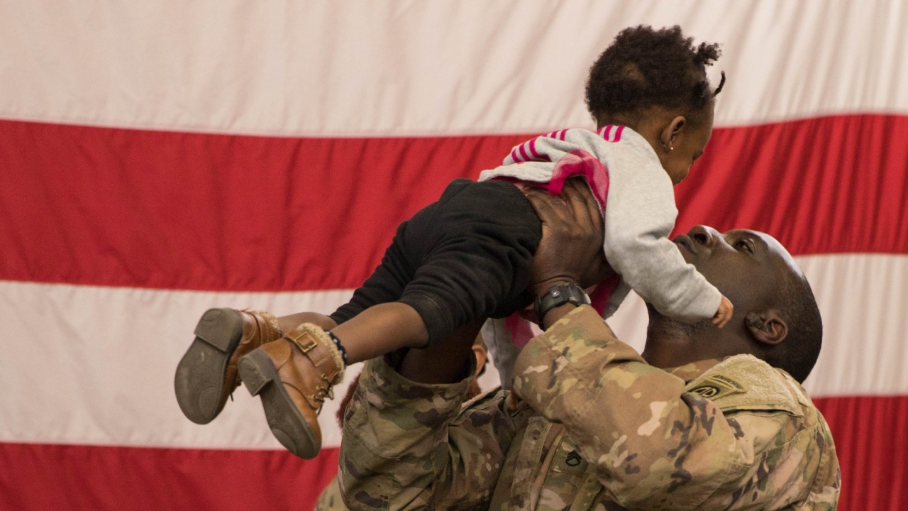 Soldier holds his daughter