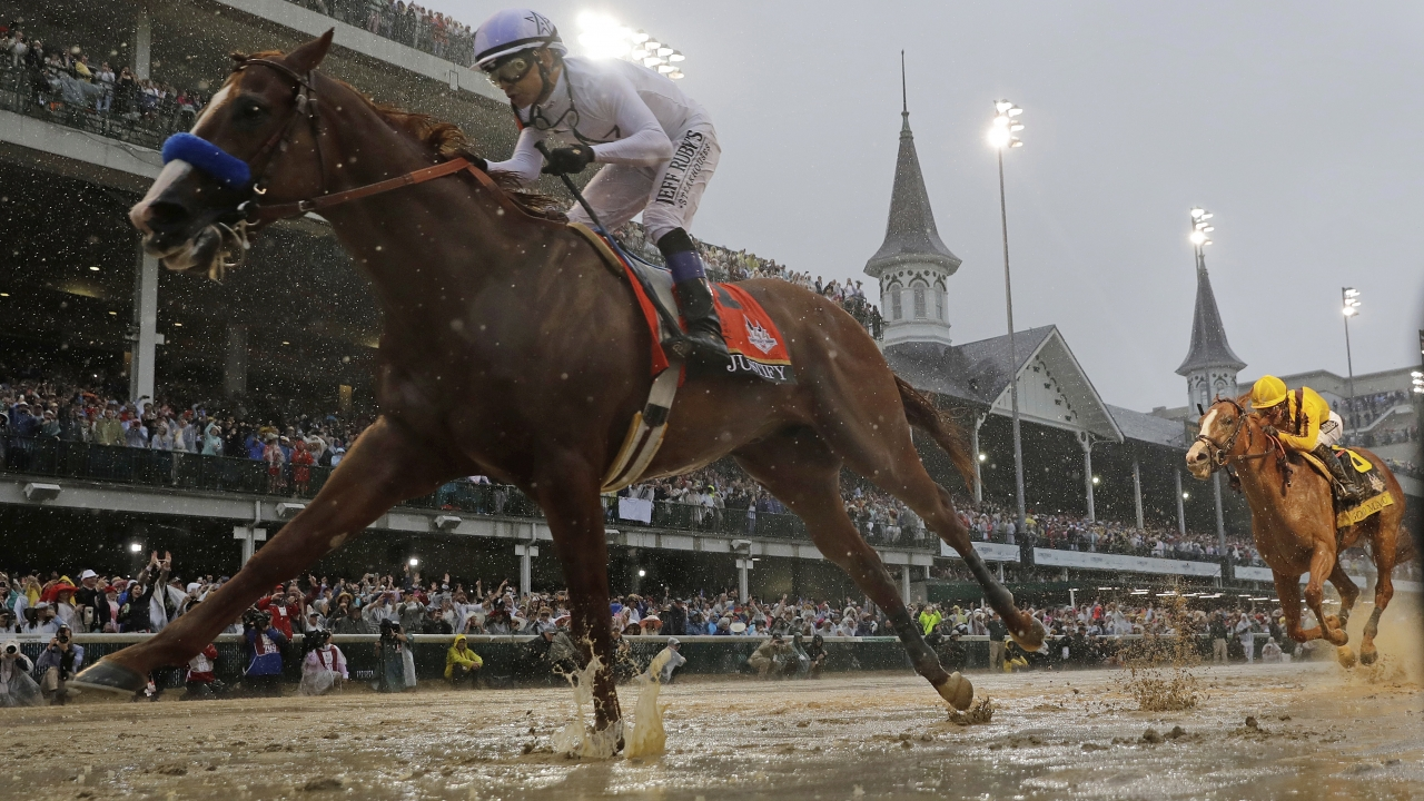 Jockey Mike Smith and the horse Justify ride to victory in the 2018 Kentucky Derby.