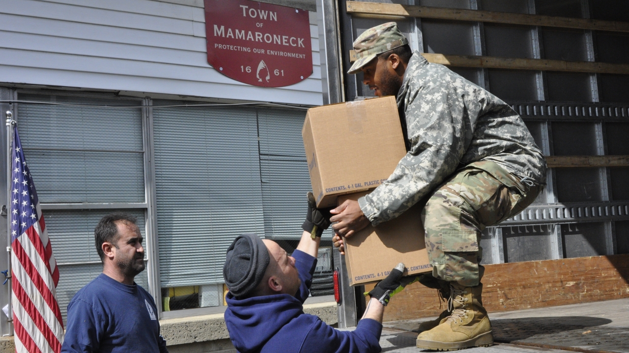 A member of the New York National Guard carries supplies