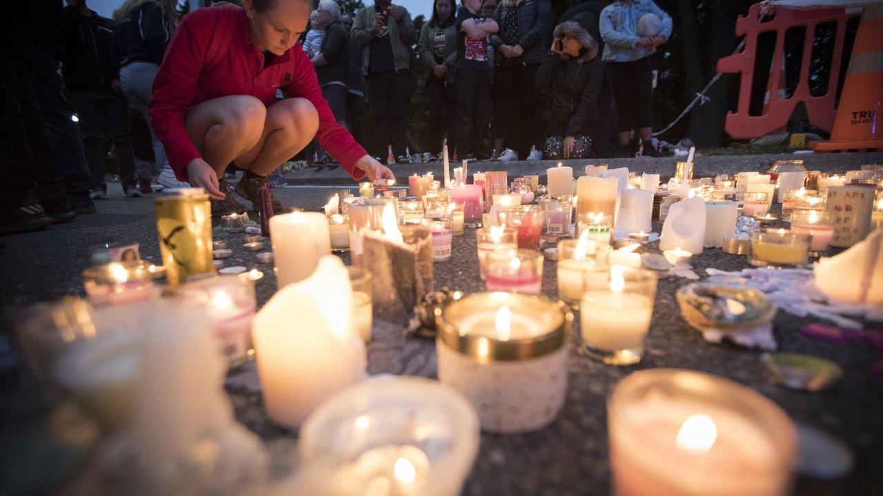 Candles honor the victims of the Christchurch mosque attacks