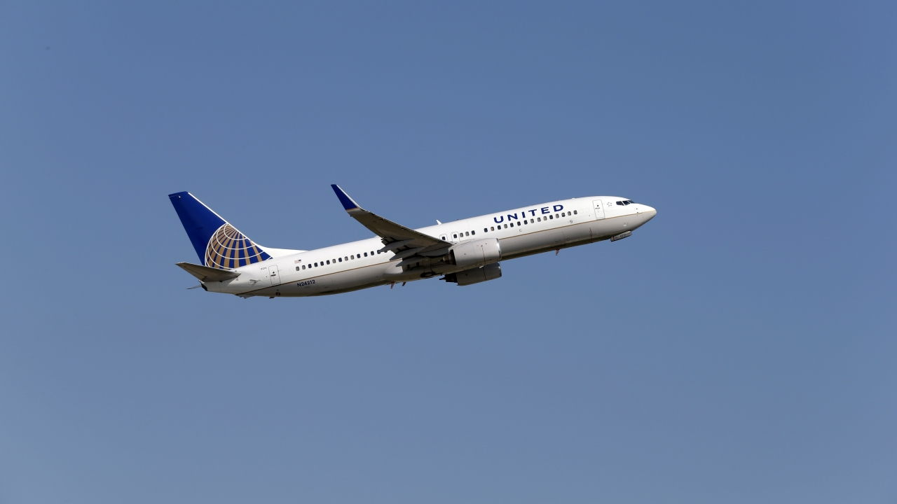 A United Airlines plane departs an airport.