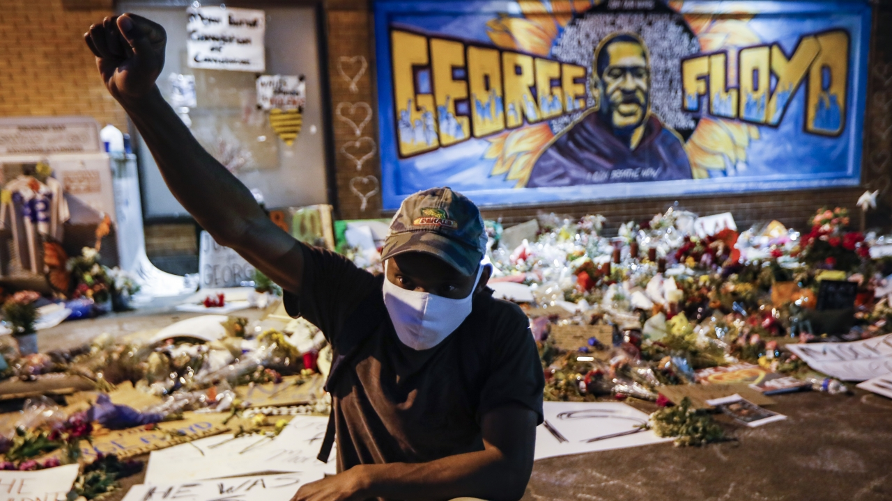 Protesters gather at a memorial for George Floyd