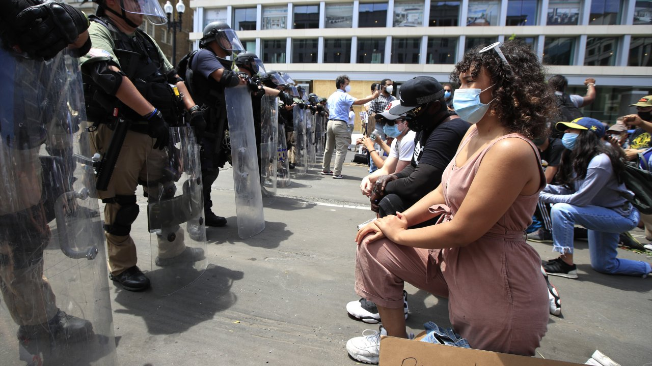 Protesters kneel before law enforcement in Washington, D.C.