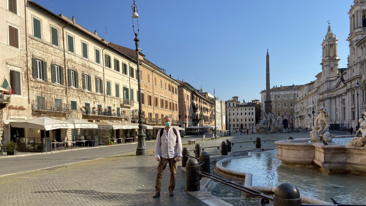 Journalist and American expatriate John Henderson on the empty streets of Rome in April.