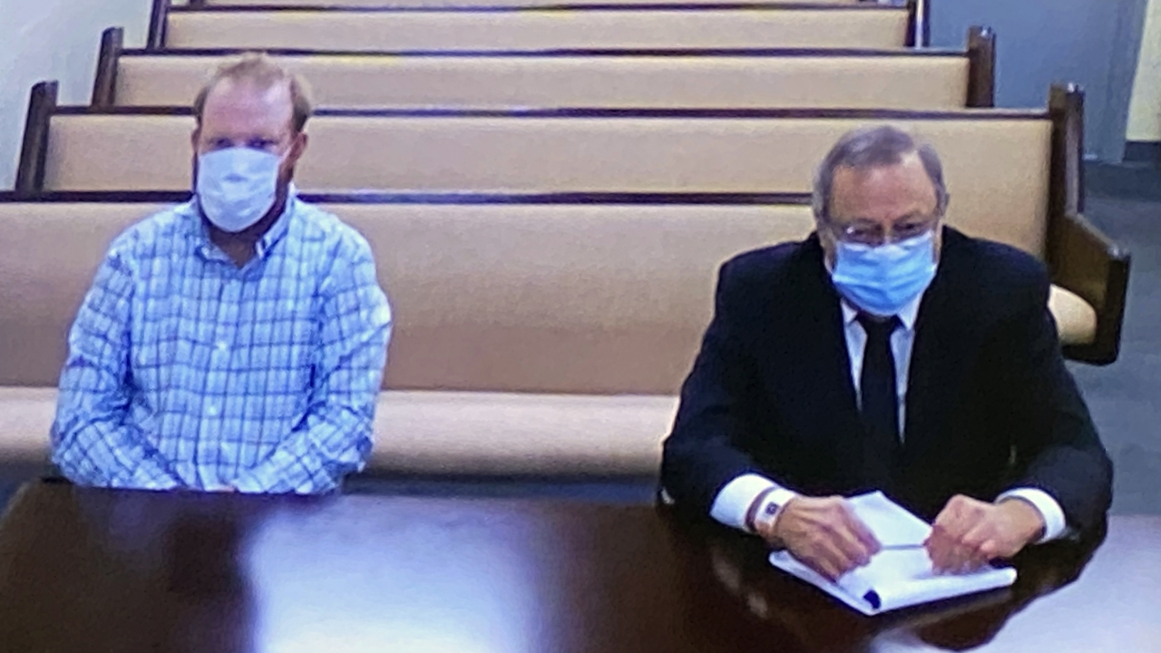 Greg and Travis McMichael during a preliminary hearing