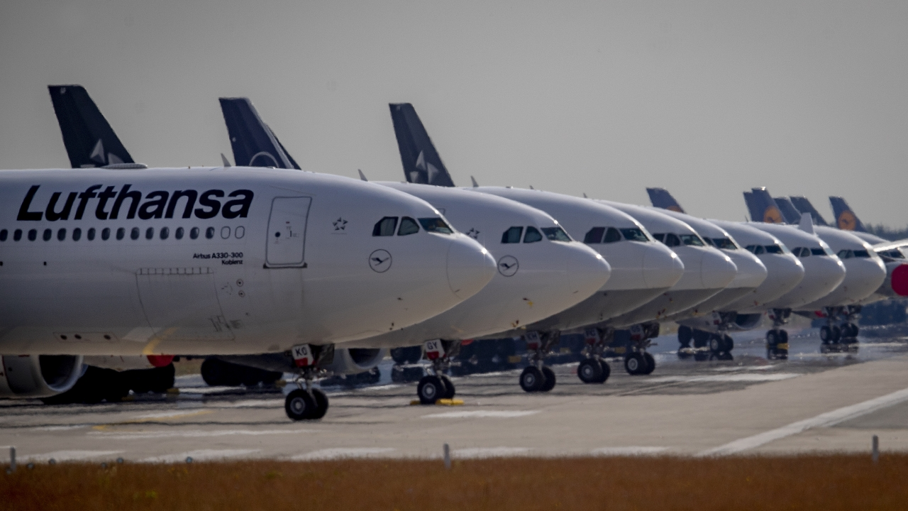Lufthansa planes sit grounded at an airport