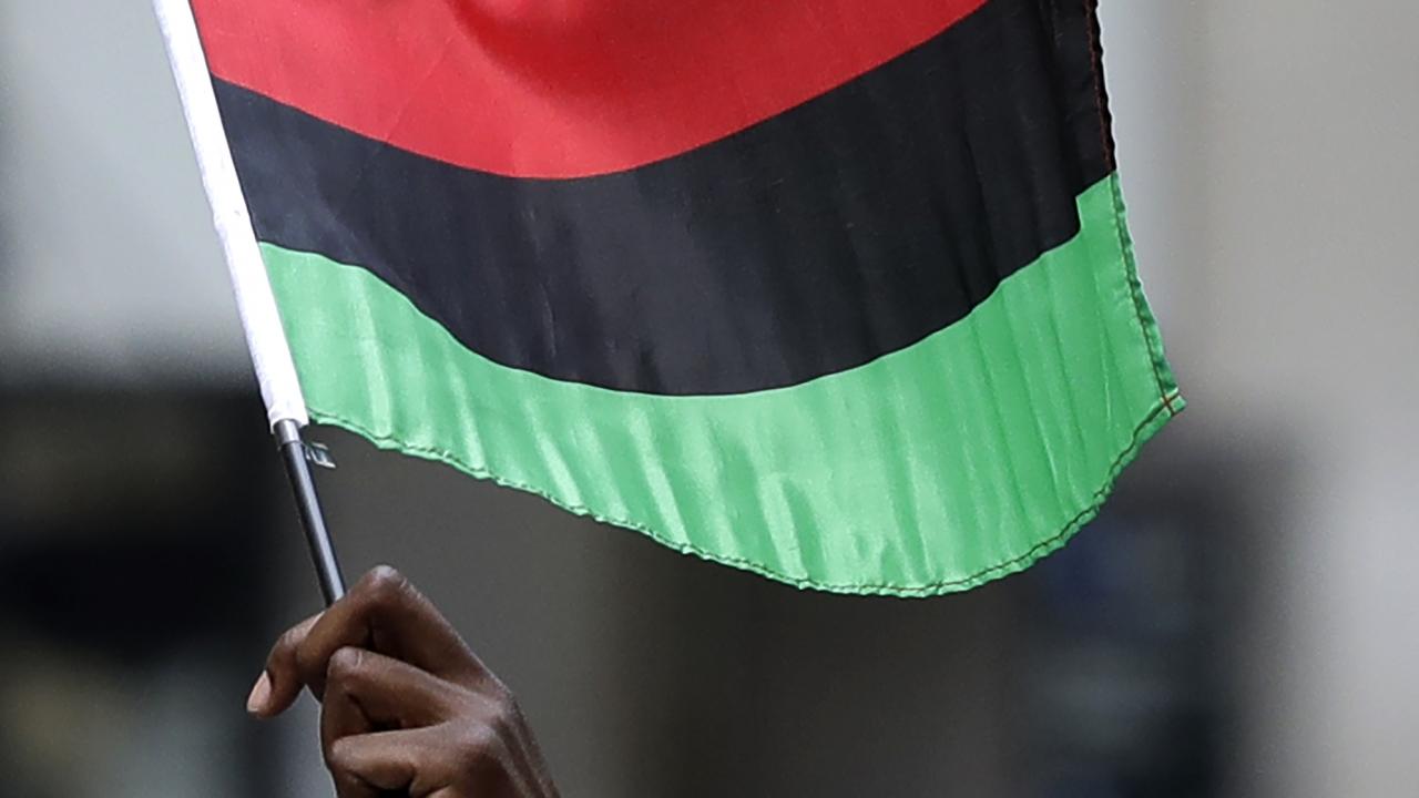 Man holding pan-African flag