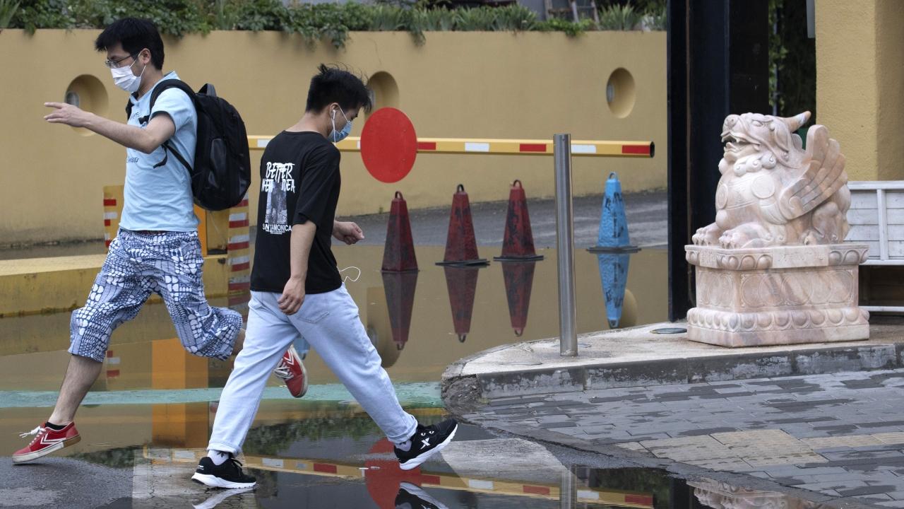 Beijing residents wear masks