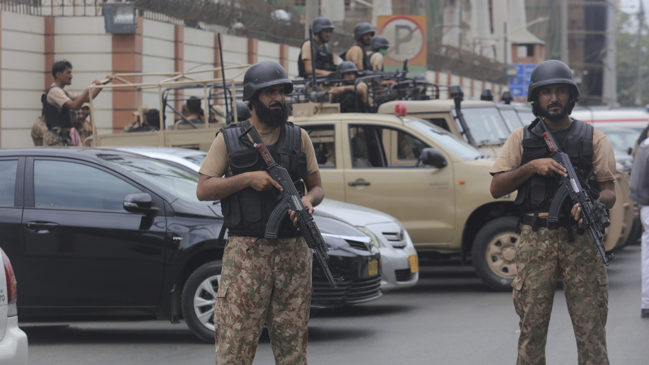 Security personnel surround the Stock Exchange Building after an attack in Karachi, Pakistan
