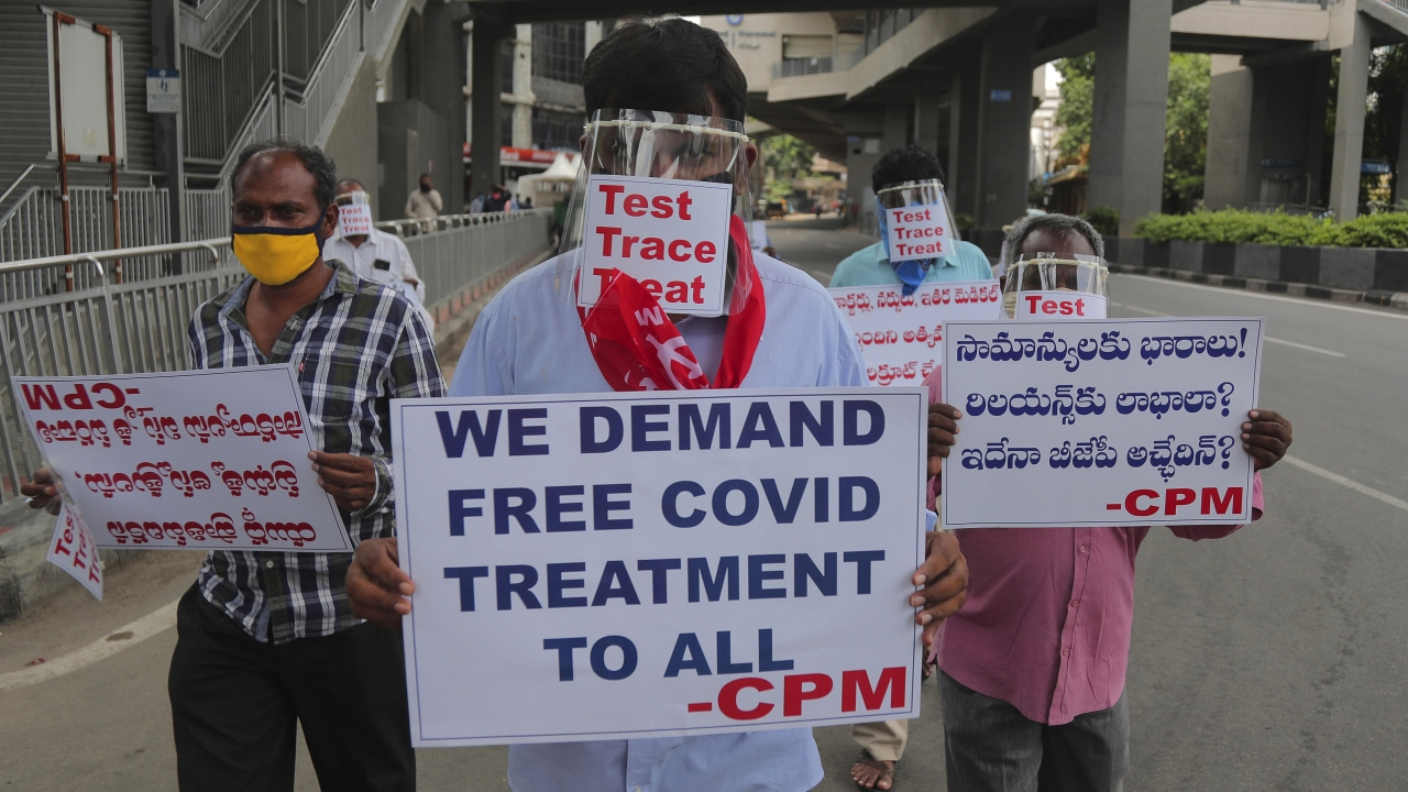 Communist Party activists in Hyderabad, India, calling for COVID-19 testing and free treatment