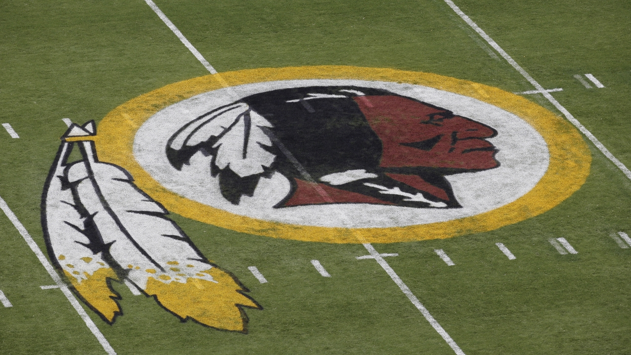 Washington Redskins logo on field before 2014 preseason game.