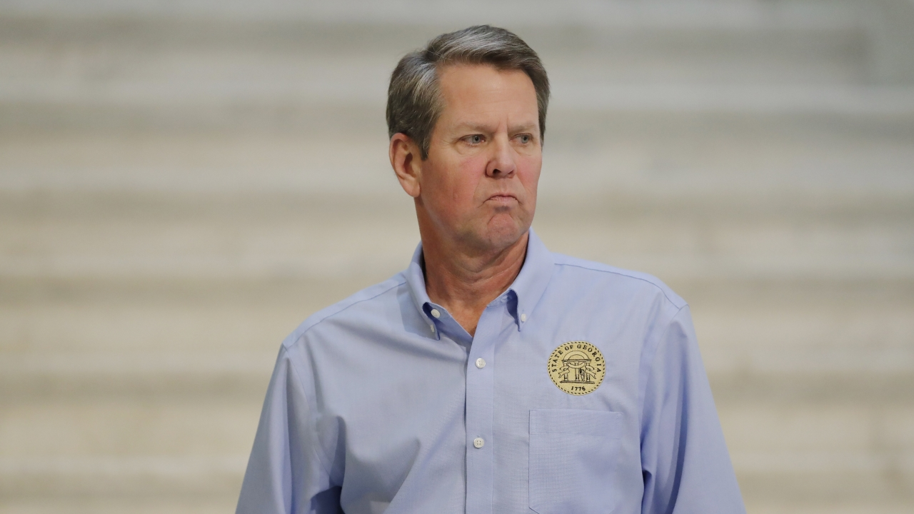Georgia Gov. Brian Kemp walks away after speaking during a news conference at the state Capitol in Atlanta