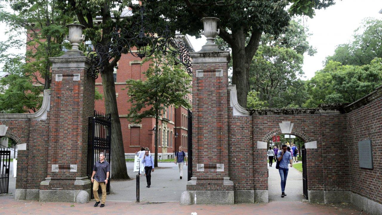 People walking through the gates of Harvard Yard at Harvard University