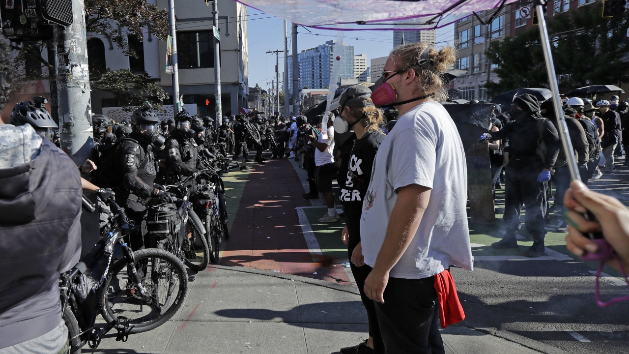 Police square off with protesters Saturday, July 25, 2020, near Seattle Central Community College in Seattle