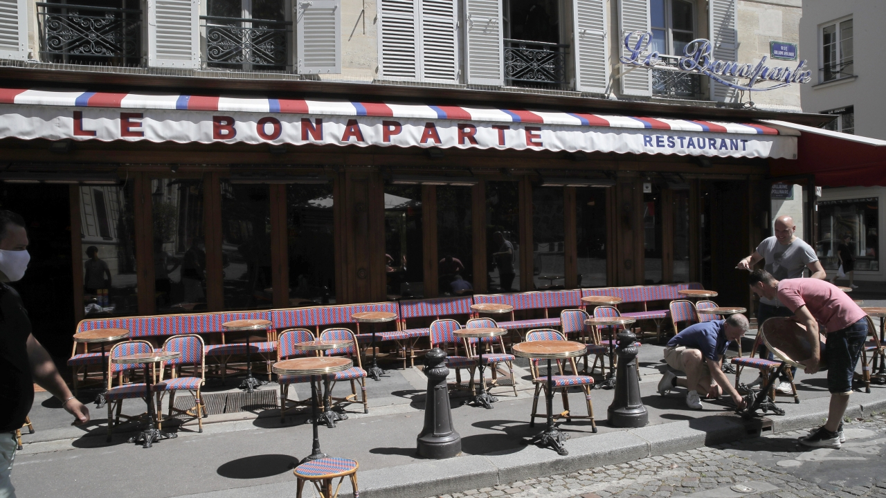 Parisian waiters move tables apart