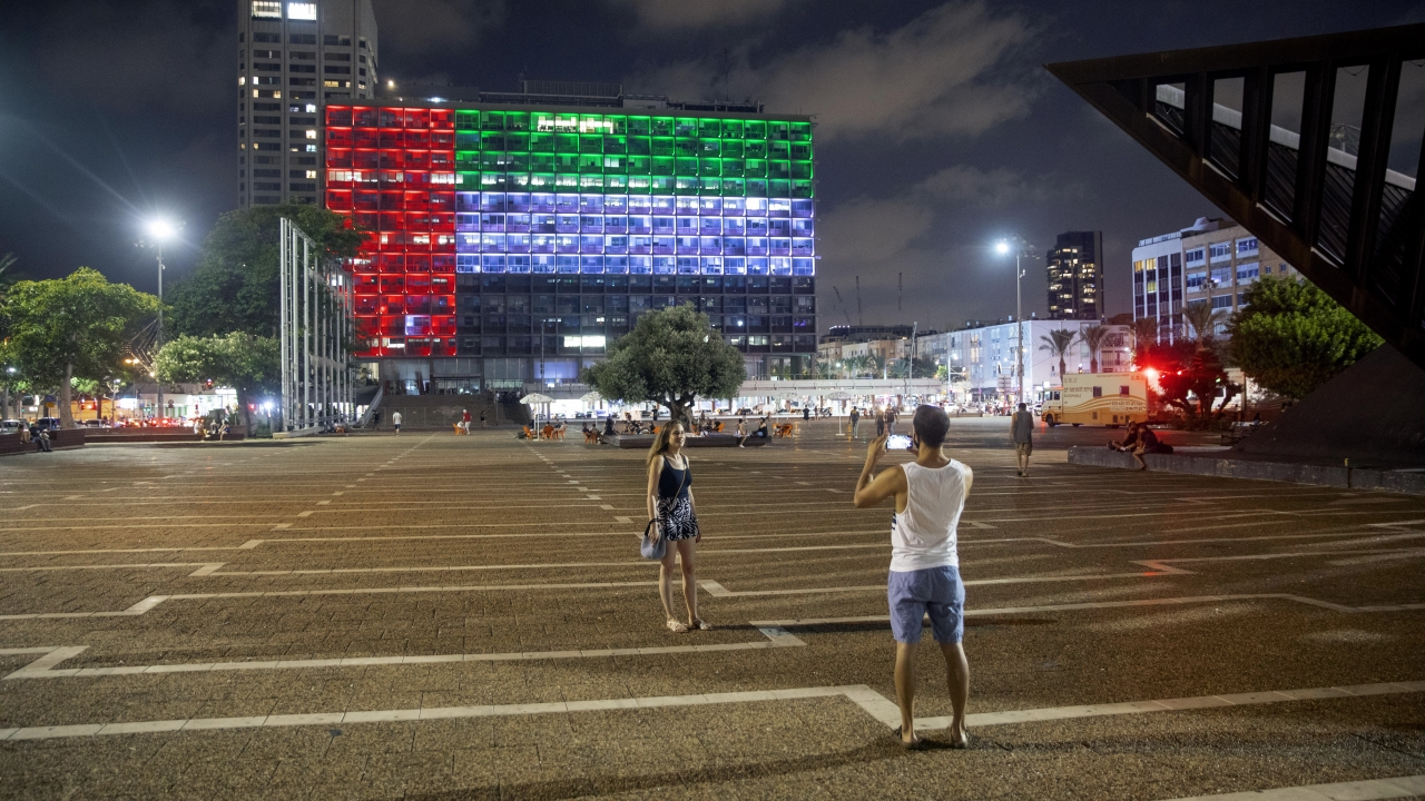 Tel Aviv City Hall is lit up with the flags of the United Arab Emirates and Israel as the two announced diplomatic ties.