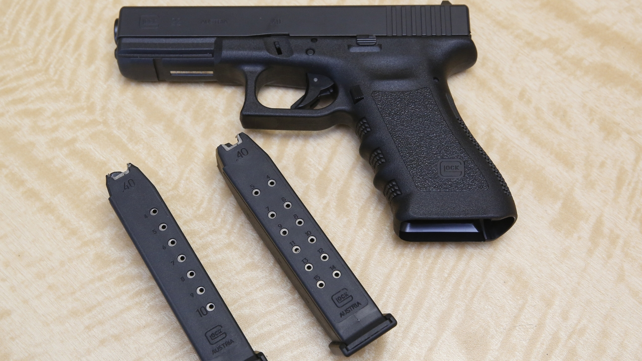 A semi-automatic hand gun with a 10 shot magazine, left, and a 15 shot magazine, right, at a gun store in California.