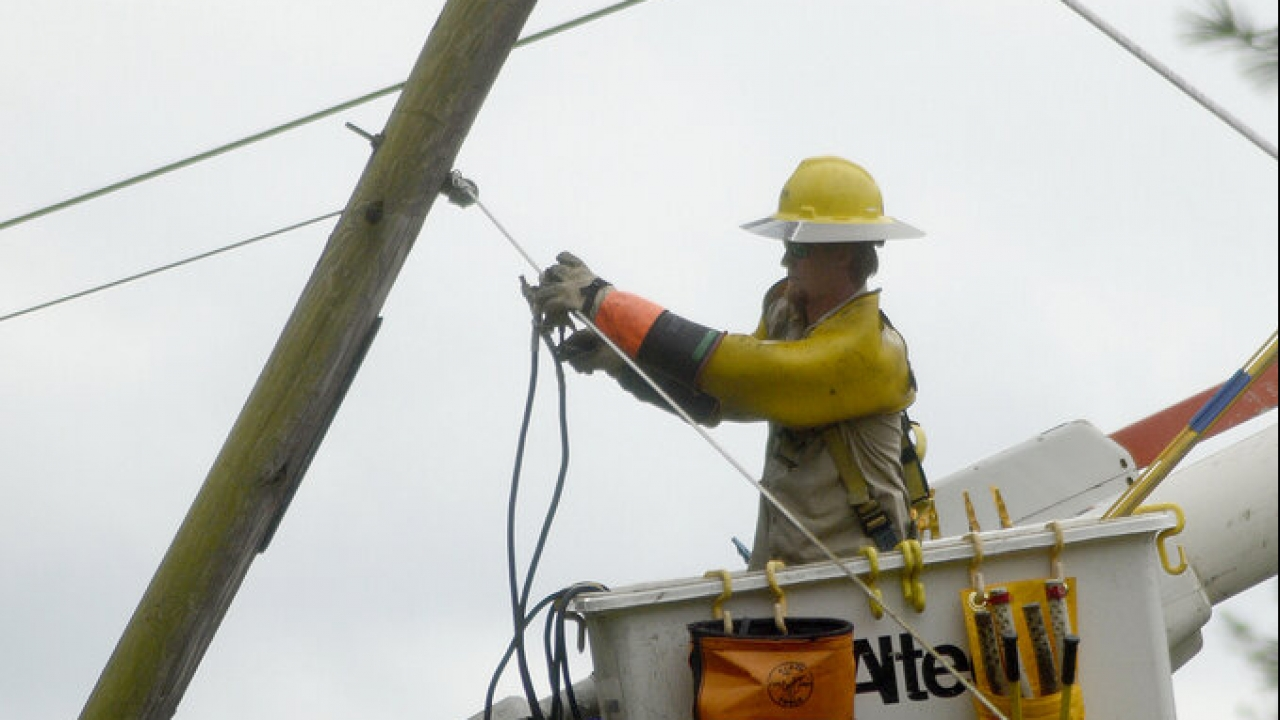 Cleaning up damage from Hurricane Delta