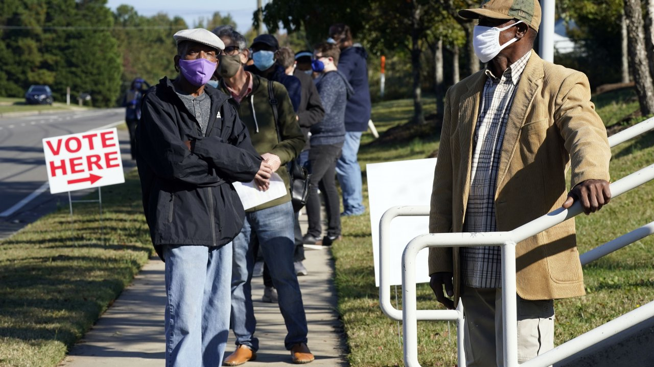 Early voters line up to cast their ballots in North Carolina.