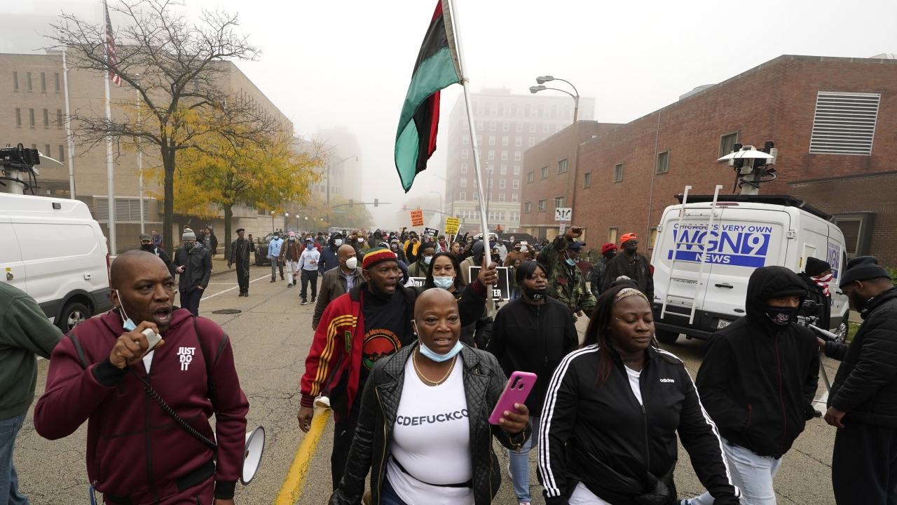 People march during a protest rally for Marcellis Stinnette who was killed by Waukegan Police last Tuesday in Waukegan, IL.