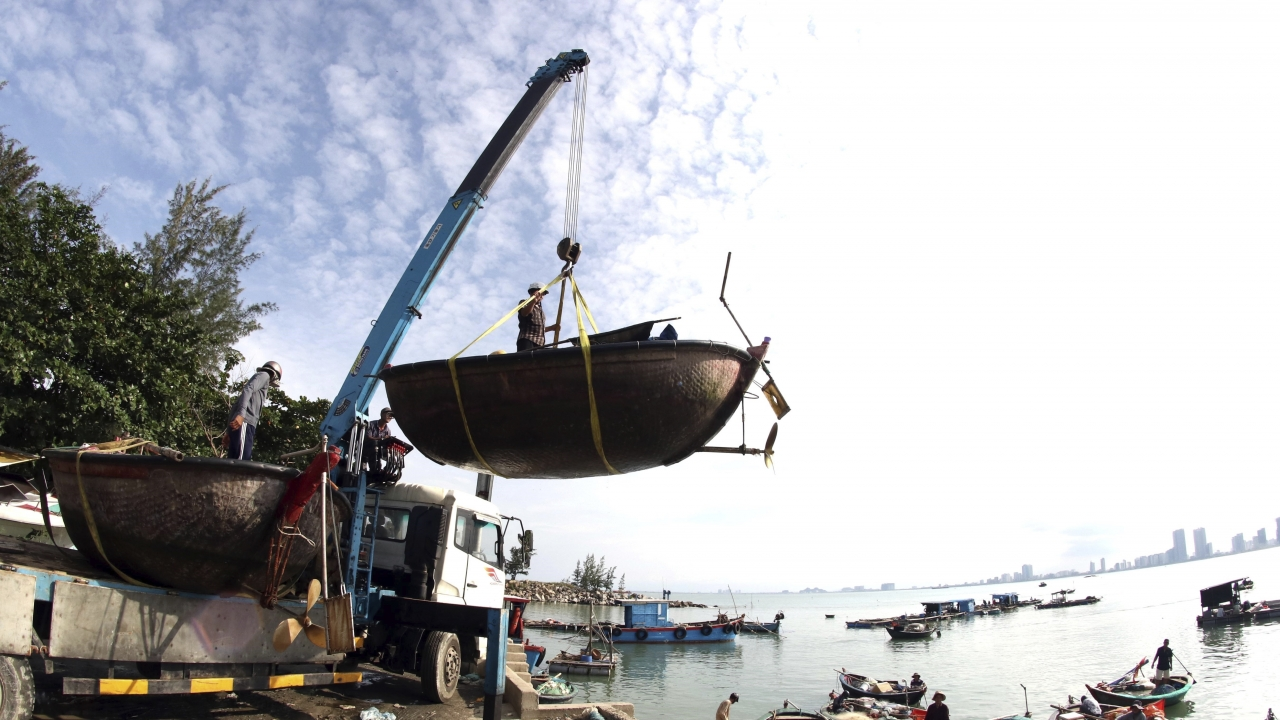 People move fishing boats to save place ahead of Typhoon Molave in Danang, Vietnam