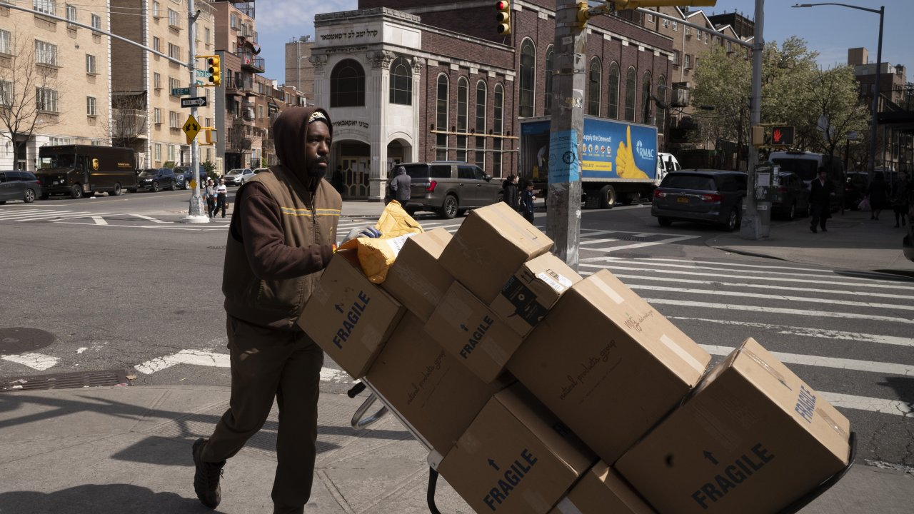 A UPS driver delivers packages during the coronavirus pandemic