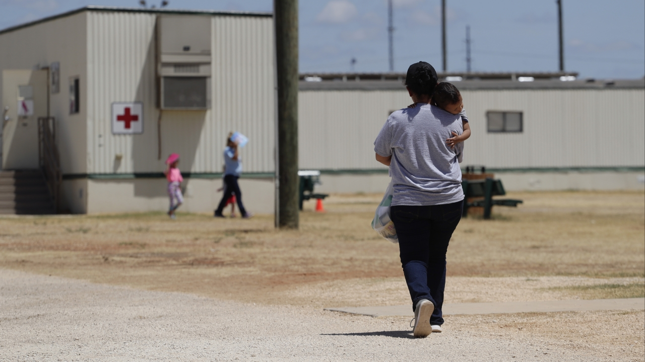 Immigrants seeking asylum walk at the ICE South Texas Family Residential Center, in Dilley, Texas in August 2019.